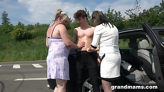 Two chubby matured women bang young student on hammer away road