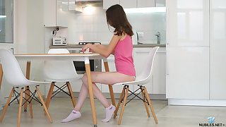 Cute skinny teen Ariel Tylor is maturating pinkish pussy made-to-order the kitchen table